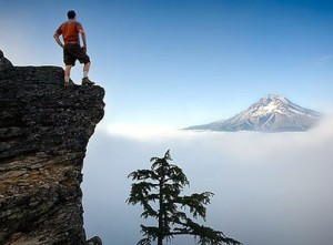 man-on-mountain-top-300x221